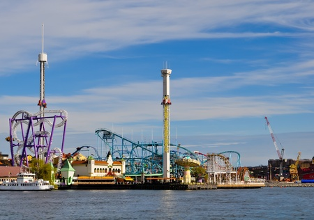 amusement park with colorful attractions at the waterfront in stockholm, sweden Stock Photo