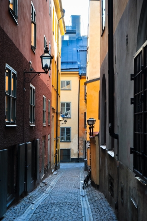 narrow alley with colorful houses in an old town