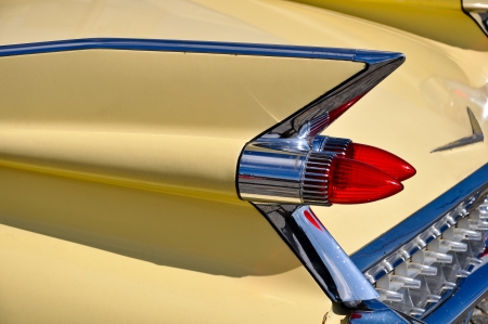 fins: details of an old timer car including tail fin and lights