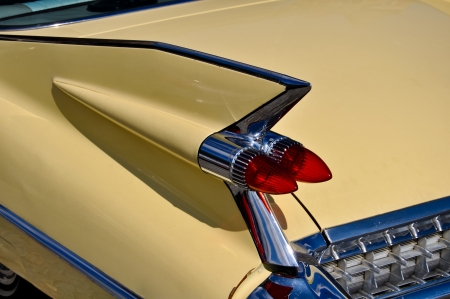 car grill: details of an old timer car including tail fin and lights