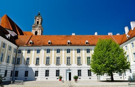 courtyard of baroque herzogenburg monastery in austria on a summer day photo