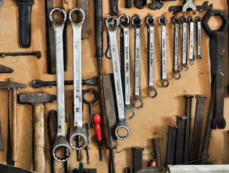 workbench: different tools organized on a wall Editorial