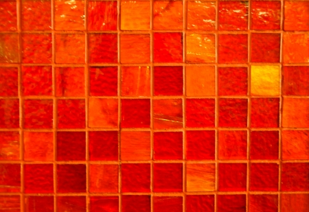 wall of orange glass mosaic tiles photo