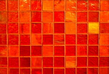 tiled wall: wall of orange glass mosaic tiles Stock Photo