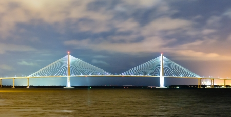 illuminated suspension bridge in charleston, SC at night photo