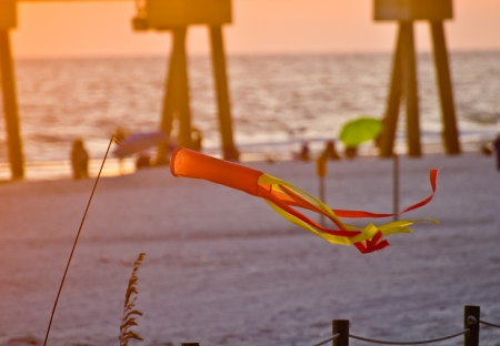 wind chime: windchime on a beach scene at sunset Stock Photo