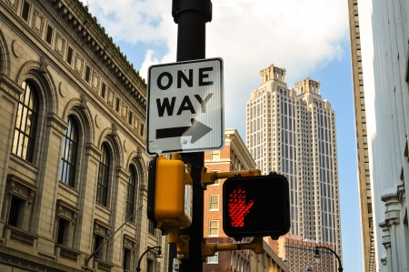 one way-sign with traffic light in front of atlanta skyline