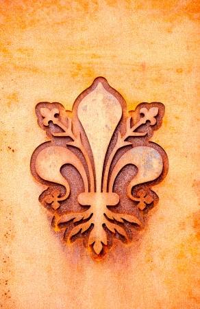 lelie bloem symbool op een metalen plaat