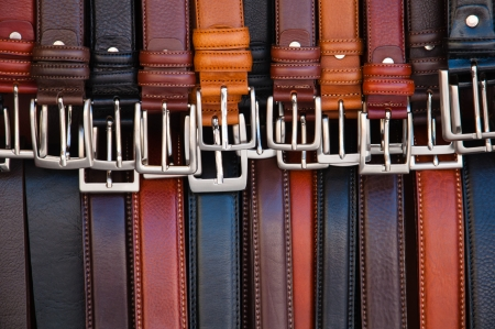 set of leather belts on display
