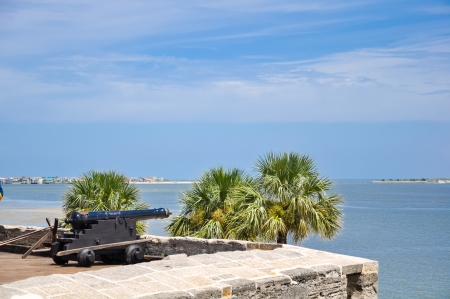 antique cannon at st  augustine fort overlooking the bay Stock Photo - 24500511