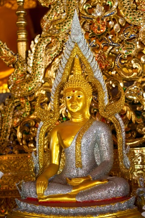 Buddha statue in Pan-Ping temple,Chiangmai,Thailand (Generality in Thailand,any kind of art decorated in temple created with  money donated by people to hire artist. They are public domain or treasure of Buddhism,  no restrict in copy or use)