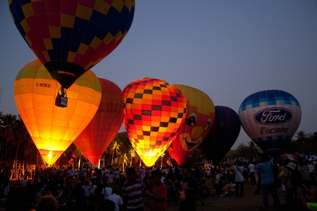 atmosphere of hot air balloon festival in Thailand International Ballon Festival 2011 in the evening
