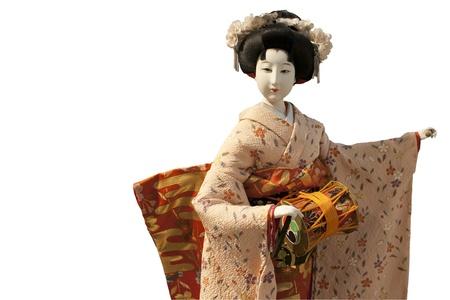 A japanese doll of a woman playing her music instrument