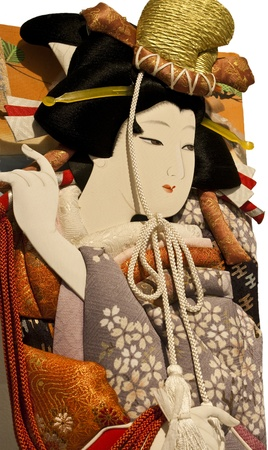 a beautiful woman design on a oshie hagoita (a japanese doll)
