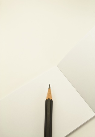 blank notepad paper and a pencil on white background Stock Photo
