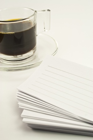 coffee time and a book of lined paper on white background photo