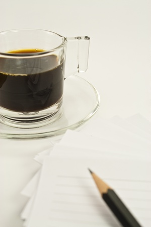coffee time and lined notebook for reminder  and a pencil on white background photo