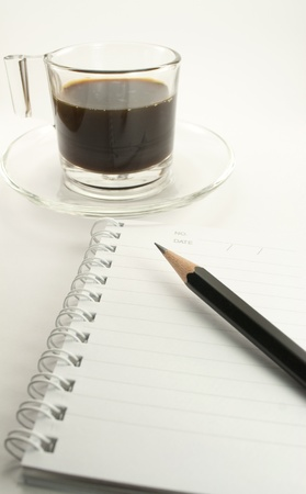 coffee time and lined notebook for reminder  and a pencil on white background Stock Photo - 12741371