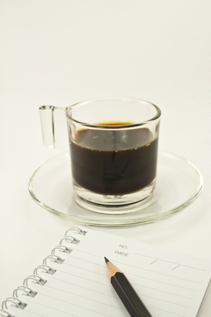 coffee time and lined notebook for reminder  and a pencil on white background Stock Photo - 12741908