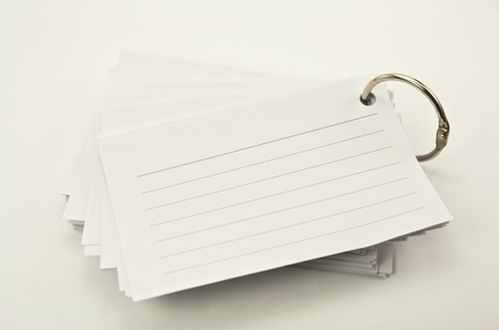 book of lined notepad with ring on white background