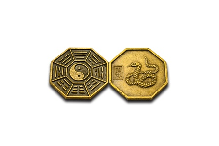 yin-yang brass coin and design of snake on brass coin