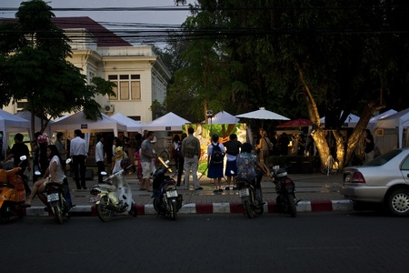 CHIANG MAI, THAILAND - MARCH 23: An atmosphere of the audiences during viewing the artist painting there 3D artwork on street in the evening in  Chiang Mai Fest and Art on the Street 2012,Chiang Mai, Thailand on 23 March,2012. Stock Photo - 12878070