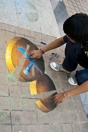 CHIANG MAI, THAILAND - MARCH 23: An artist during painting his 3D artwork on street in  Chiang Mai Fest and Art on the Street 2012,Chiang Mai, Thailand on 23 March,2012.