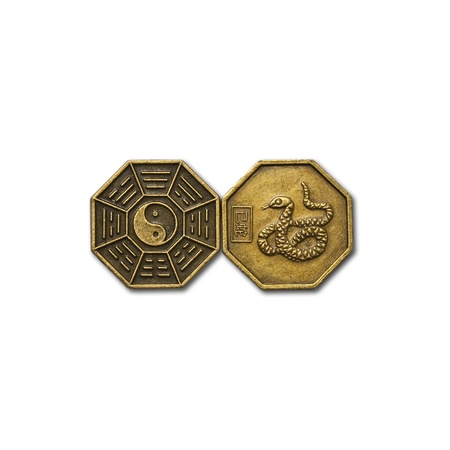 yin-yang brass coin and design of snake on brass coin photo