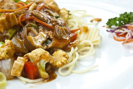 vegetarian food   spaghetti in tomatoes sauce with mushroom, tofu and vegetables in thailand