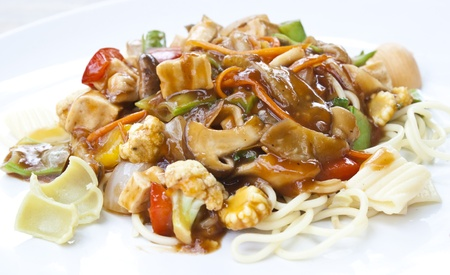 vegetarian food   spaghetti in tomatoes sauce with mushroom, tofu and vegetables in thailand photo