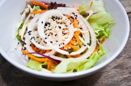 carot: a bowl of fresh vegetable salad  side dish  onion,cabbage,carot,sesame Stock Photo