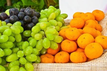 fruit basket of grave and orange photo