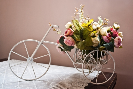 vintage bicycle model with dummy flower for room decoration photo
