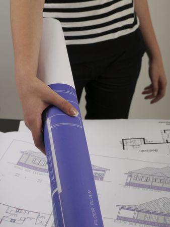 Woman holding blueprints photo