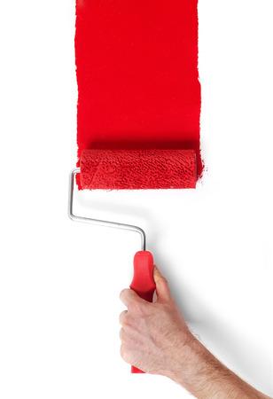 peintre en b�timent: Main avec un rouleau � peinture isol� sur blanc