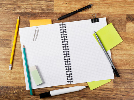Blank notebook with supplies on white Stock Photo