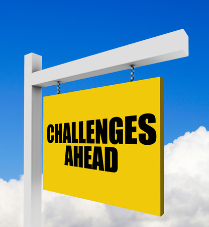 challenges ahead: Challenges ahead sign on blue sky