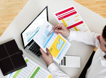 stock market chart: Business man working on financial data Stock Photo