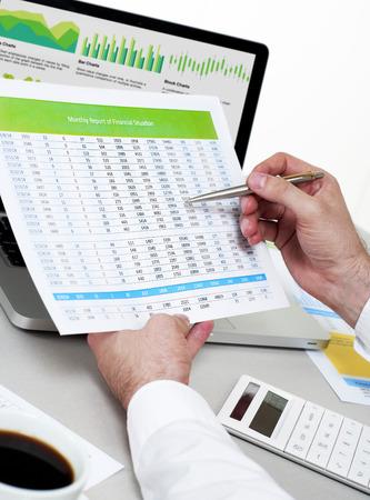 stock market chart: Businessman analysing financial data