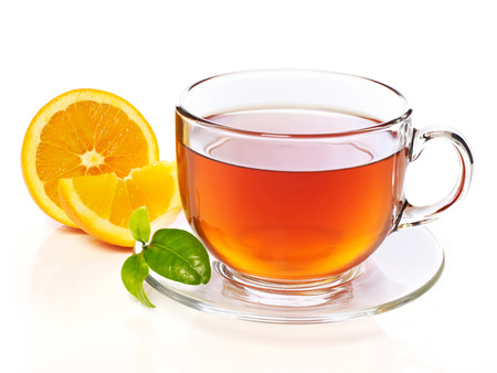 Cup of tea with orange slice, isolated on white 免版税图像