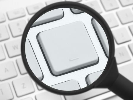 teclado de computadora: Lupa sobre un teclado de computadora