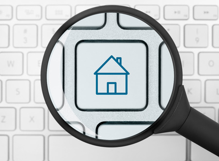 House icon under the magnifying glass photo