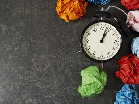 12 oclock: Table clock and paper balls with copyspace
