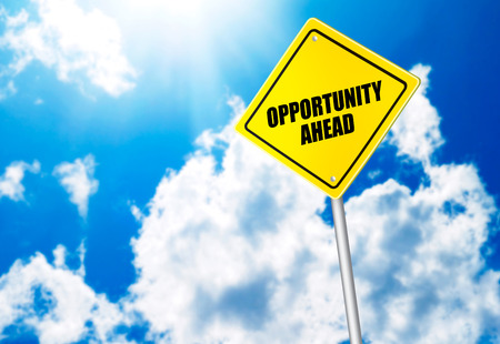 Opportunity ahead message on road sign photo