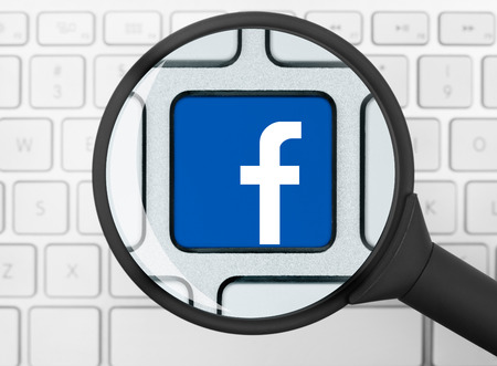 Facebook icon under the magnifying glass