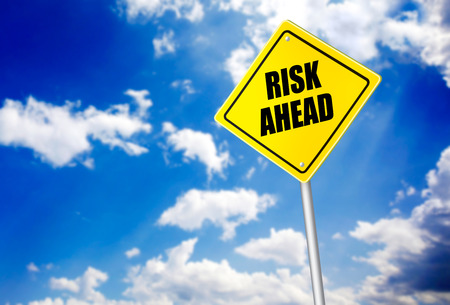 risk ahead: Risk ahead message on road sign Stock Photo