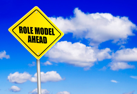 Role model ahead message on road sign
