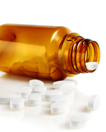 spilled: Pills spilled out of bottle Stock Photo