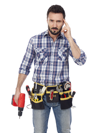 toolbelt: Handyman with toolbelt and drill