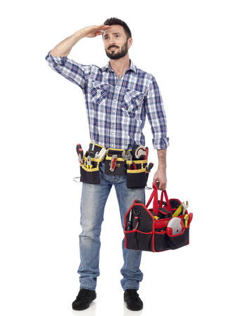 tools belt: Handyman with toolbox looking into the distance